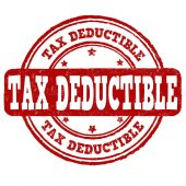 Tax deductible grunge rubber stamp on white background